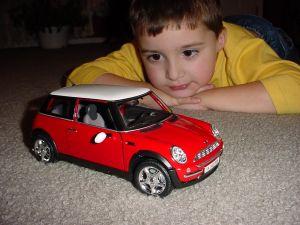 8324_boy_admiring_car.jpg