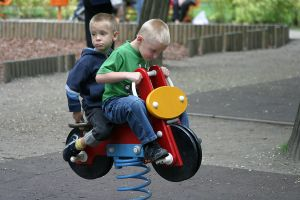 952428_kids_on_toy_bike.jpg